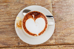 A cup of latte coffee. Top view on old wood background stock image