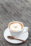 Cup of latte coffee. On wood table Stock Images