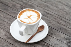 Cup of latte coffee. On wood table Royalty Free Stock Photo