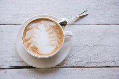 The Cup of latte coffee on wooden table Stock Images