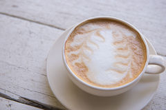 The Cup of latte coffee on wooden table Stock Photography