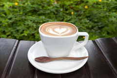 Cup of latte coffee on wooden Stock Image
