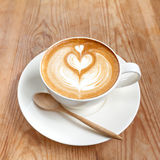 Cup of latte coffee on wooden Royalty Free Stock Image