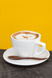 Cup of latte coffee. On yellow background Royalty Free Stock Photos