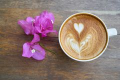 Cup of latte with flowers