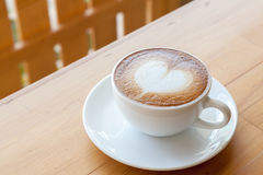 A cup of latte on the table Stock Images