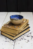 Cup with a lavender. On old books Royalty Free Stock Photos