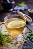 A cup of lavender tea. A cup of healthy lavender tea with lemon Royalty Free Stock Photo