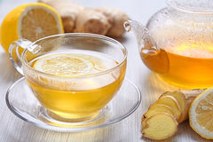 Cup of lemon and ginger tea. Cup of ginger tea with honey and lemon on wooden table stock photography