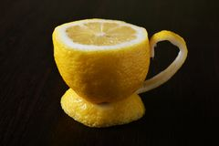 A cup of lemon. On a wooden table Stock Photos