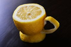 A cup of lemon. On a wooden table Stock Photography