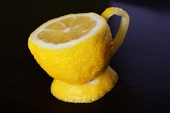 A cup of lemon. On a wooden table Stock Image