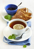Cup of Lemon Tea and crepes with jam Stock Photography