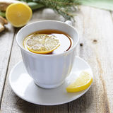 A cup of lemon tea with ginger Royalty Free Stock Image