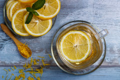 Cup of lemon tea. Lemon tea in a glass cup on blue rustic background Stock Photo