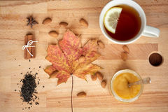Cup of lemon tea and honey on wooden board Royalty Free Stock Photo
