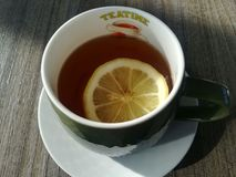 Cup of lemon tea, international breakfast royalty free stock photography