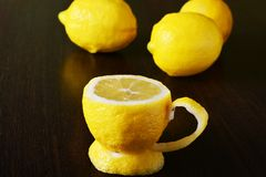 A cup of lemon. On a wooden table Royalty Free Stock Images