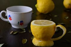 A cup of lemon. On a wooden table Royalty Free Stock Photo