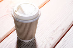 Cup with a lid. Royalty Free Stock Images