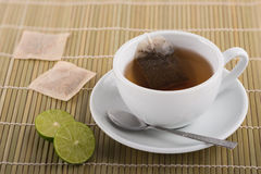 Cup of lime tea. On bamboo background Stock Photography