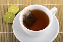 Cup of lime tea. On bamboo background Royalty Free Stock Photo