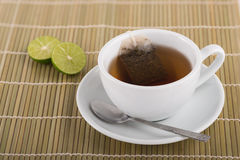 Cup of lime tea. On bamboo background Royalty Free Stock Image