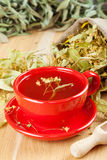 Cup of linden tea and flowers in canvas bag Stock Photography