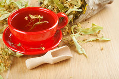 Cup of linden tea and flowers in canvas bag Royalty Free Stock Images