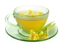 Cup of linden tea and flowers Stock Photos