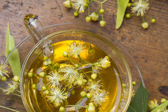 Cup with linden tea Royalty Free Stock Image