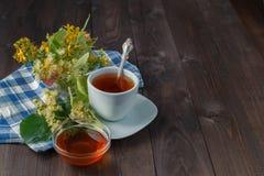 Cup with linden tea royalty free stock photos