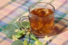 Cup with linden tea. On a textile napkin Stock Photography