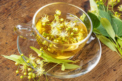 A cup with linden tea Royalty Free Stock Image