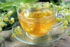 Cup of linden tea on a wooden table. vitamins tea. Close-up Stock Photography