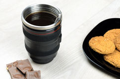 Cup that looks like a camera lens Royalty Free Stock Images