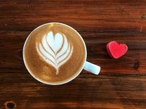 Cup of love , heart latte art coffee in white cup and red love heart. On the vintage wooden table. Love coffee love in your cup. Wake up and full fill energy Royalty Free Stock Photos