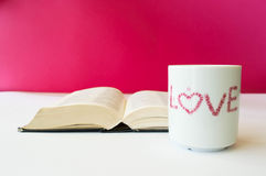 Cup of love. And love reading books Royalty Free Stock Image