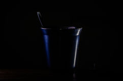 Cup. Low key image of an cup and little spoon Royalty Free Stock Photography