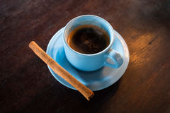 Cup of Luwak coffee with ginger stick sold in Bali, Indonesia stock image