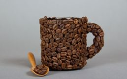 Cup made from coffee beans Royalty Free Stock Photo