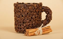 The cup made from coffee grains, and cinnamon Stock Photo