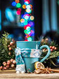 Cup with magic colorful lights and spices. royalty free stock images