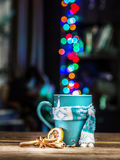 Cup with magic colorful lights and spices. stock photos