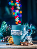 Cup with magic colorful lights and spices. Stock Photography