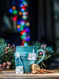 Cup with magic colorful lights and spices. Christmas. royalty free stock photos