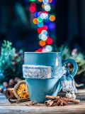 Cup with magic colorful lights and spices. Royalty Free Stock Photography