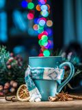 Cup with magic colorful lights and spices. Royalty Free Stock Photo