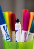 Cup of Markers. Colored markers sitting in a green cup Royalty Free Stock Photo