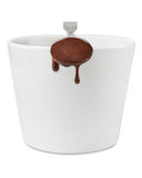 Cup with melted chocolate Stock Photos